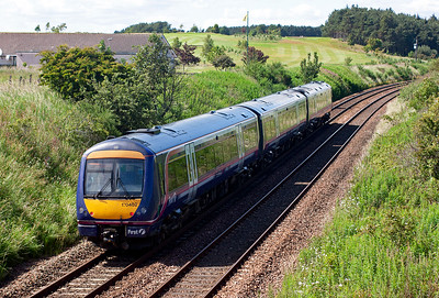 170402 is recorded heading for Dundee from Leuchars with 1L55 1400 Edinburgh to Dundee. The location is the overbridge leading to Leuchars Golf Club. 28/6/2011