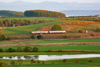 Back to Little Couston but in the evening and looking over from the opposite side of the valley and an unidentified class 158 sprinter catches the glint with 1L06 2000 Perth to Edinburgh.
