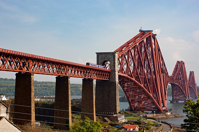 A classic shot of an icon. The Forth Bridge stands sentinel over the River Forth carrying far more trains than when it was built in 1890. An unidentified class 158 Sprinter clears the north portal with 2K31 1547 Newcraighall to Edinburgh via the inner Fife Circle. 23/5/2012