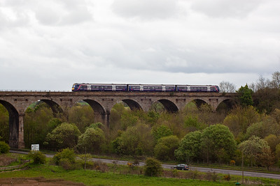 An unknown class 170 turbostar passes over Markinch Viaduct bound for Aberdeen working 1A71 1128 off Edinburgh. This service is not booked to stop at Markinch. 14/5/2012