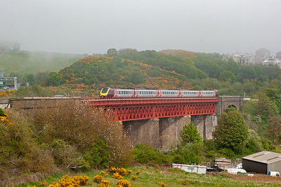 Class 221 Super Voyager 221130 passes over the viaduct climbing at 1 in 70 for the Forth Bridge. This is the long distance 1V60 0820 Aberdeen to Penzance cross country service.