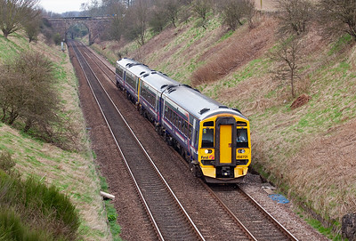 Another northbound working sees two class 158 sprinters form 1H11 1036 Edinburgh to Inverness. 158712 and 158707 drone their way up the bank to Lochmuir Summit.