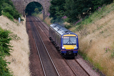 ScotRail turbostar 170433 climbs the 1 in 102 1/2 of Lochmuir Bank with 1A79 1629 Edinburgh to Inverurie service. It looks like the driver is standing by the cab door. 31/7/2013