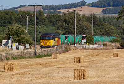 In glorious September sunshine Colas 56105 crosses the road at Bow of Fife with 6N72 1448 WO Linkswood to Grangemouth empty aviation fuel tanks. 4/9/2013