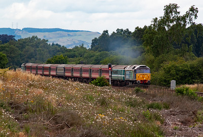 With power on 47805 leads 1Z91 1637 Dundee to Blackpool returning railtour passing over the high ground at Lochmuir before starting the drop to Markinch and beyond.