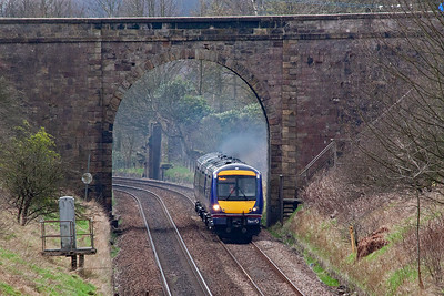 This location is near the top of Lochmuir Bank, and looking south towards Markinch sees a clagging well class 170 turbostar 170421 passes below the road bridge to Star and Kennoway.