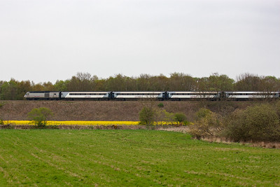 The East Coast operated service speeds on with Leuchars as its next stop. The line is carried on a high embankment climbing at 1 in 160 stiffening to 1 in 129 just by here.