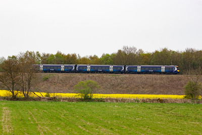 An unknown turbostar comes south with 1B31 1253 off Inverness to Edinburgh.