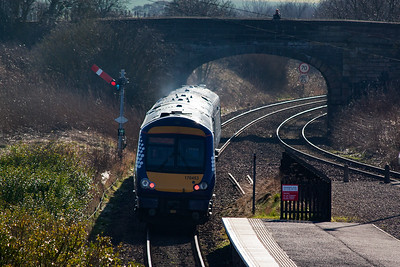The departing shot of 170453 passing the up starter located away from the end of the island platform.