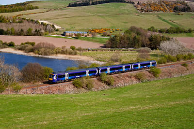 The wonderful late April sun shines down on the single line Newburgh branch from Ladybank to Hilton Junction. 170456 in the new ScotRail livery passes by Lindores Loch with 1B31 1253 Inverness to Edinburgh, what a lovely location.