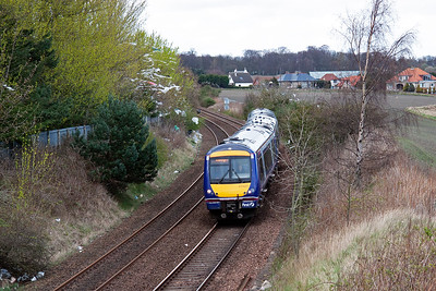 "A move to Dysart to wait for the tour which was put inside at Thornton to allow this train to overtake. 170420 passes by the site of the ""Dubbie Shunt"", the exchange sidings for the now long closed Francis Colliery, with 1B40 1524 Inverurie to Edinburgh service."