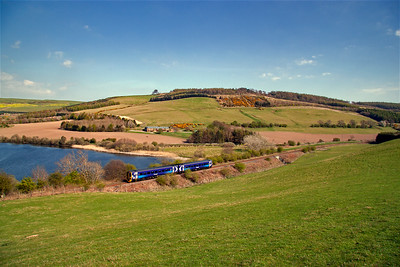 Bringing the lens right out to record the whole vista at this wonderful location by Lindores. The railway, once double track, skirts western shore of Lindores Loch with its blue waters popular with fishermen.