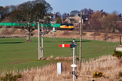 One of the last few remaining freight workings through Fife comes towards the station in wonderful sunlight with 56094 passing the down advanced starter with its rake of 20 empty TTA tanks.