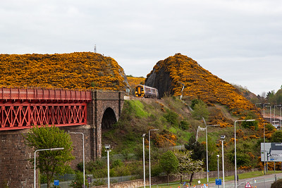 The evening rush is starting to kick in and the units are strengthened to cope.  158731 and 158721 emerges from the cutting with 2K41 1711 Edinburgh to Kirkcaldy.
