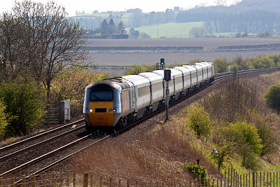 The train descends the 1 in 92 gradient and reaches the point where the embankment goes into a cutting.