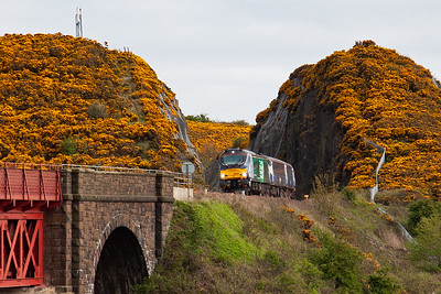 The first of the evening cats appear with 68002 emerging from the cutting and is about to run onto Jamestown Viaduct.