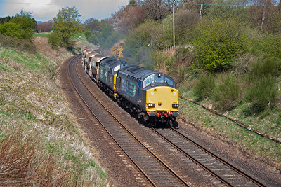 A pair of DRS class 37's charge up Falkland Road Bank at Kirkfortharfeus with 6K37 0432 Nairn to Millerhill empty auto ballasters. 37607 and 37218 make the noise with 5 vehicles on the drawbar. 28/4/2015