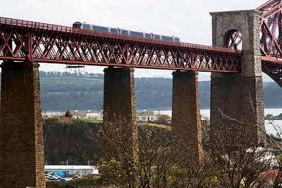An unknown class 170 turbostar rumbles onto the North Viaduct of the Forth Bridge with 2K70 1251 Glenrothes with Thornton to Edinburgh class 2 local.  20/4/2015