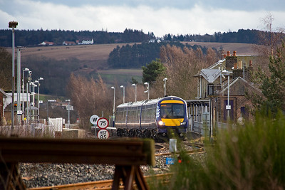 Looking over the headshunt of one of the sidings towards Ladybank station and 170459 departs with 1L55 1402 from Edinburgh to Dundee.