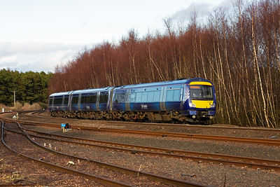 Back on the main line and 170454 comes round the curve .  Lost in the trees behind the unit is a very long siding which runs round the curve.  On the upside there was a large P Way depot with numerous buildings.