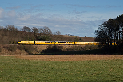 """The last day of February is cold and sunny and the afternoon sun glints off the """"Flying Banana"""", Network Rail's New Measurement Train.  43014 leads 1Q26 1345 Edinburgh to Craigentinny via Aberdeen, Dundee and Perth.  28/2/2017"""