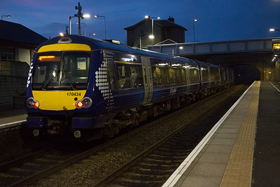 At 6.30pm in mid March there is still light in the sky as 170434 gets away after its Markinch stop with 1H17 1741 Edinburgh to Inverness.  13/3/2017