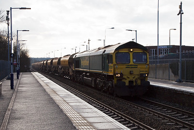 Freightliner 66536 passes through Markinch station working 6K20 1107 Millerhill to Montrose engineers train made up of 15 loaded JJA autoballaster wagons.  It is running about 30 minutes early.  29/1/2017