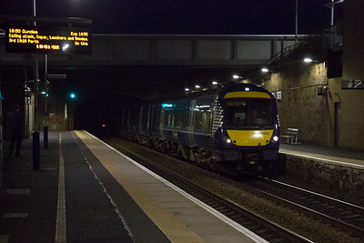 Moving to the north bound platform in readiness for a south bound freight and 170412 passes through the station non stop with 1B43 1639 Dyce to Edinburgh.