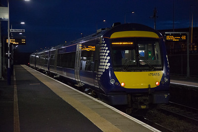 If this had been 30 seconds earlier it would have bowled the test train.  170415 has completed the station work and the driver powers up for departure.  The working is 1B54 1551 Inverness to Edinburgh.