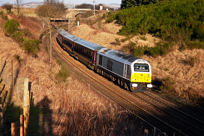 I have seen the silver liveried 67029 before but not the with EWS corporate train.  Here the special train climbs to the summit of Falkland Road bank at Kirkfortharfeus.  16/12/2005