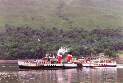 The Paddle Steamer Waverley whistles up for the steam loco as it steams in Loch Eil at Corpach. The boat was built for the LNER in 1947 and is the last ocean going paddle steamer in the World.  30/6/1997