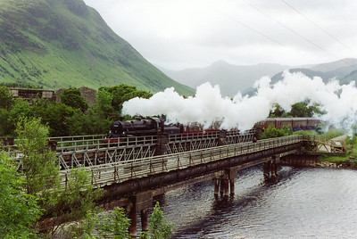 Out on the road 75014 crosses the viaduct over the River Lochy beside the ruins of Inverlochy Castle. The train ID for the steam turn is 2Y61.