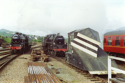 44767 moves around the shed passing 75014 and one of the two snowploughs built on a steam tender chassis.  8/7/1997