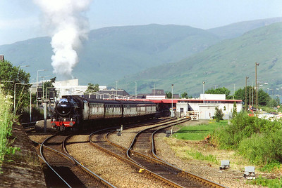 Fort William station and a chasing run to Mallaig with Richard Campbell driving. 44767 has run round its train in the station and is moving off to shunt into platform 1.  10/7/1997
