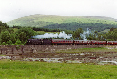 Further out the railway runs along the northern shore of Loch Eil. Here the standard class 4 is seen at Fassfern.