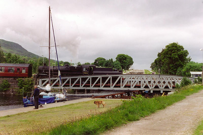At Banavie the line crosses the Caledonian Canal by means of a swing bridge, 75014 slowly eases onto the bridge. Beyond it is Neptunes Staircase which raises the Caledonian Canal 62 feet via 8 locks over a distance of a quarter of a mile.  27/6/1997
