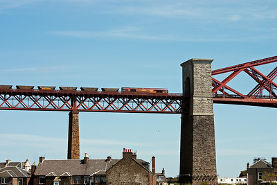 66046 fronts a rake of empty HAA coal hoppers and is about to enter the north portal to the Forth Bridge. It is forming 6J13 1222 Longannet power station to Hunterston.