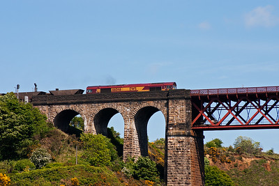 A southbound coal train eases onto the north viaduct behind 66046.