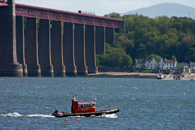 An uknown class 170 turbostar heads north with 2K05 1445 Edinburgh to Edinburgh via the Fife Circle inner or anti clockwise. On the water is a boat operated by Calypos Marine heads upstream to its moorings at nearby Port Edgar.