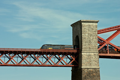 43112 emerges from the portal of the north tower in which the cantilver is anchored.