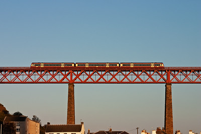 A Strathclyde Passenger Transport liveried class 170 unit heads north on the north Viaduct with 2G19 1620 Edinburgh to Cowdenbeath local working.