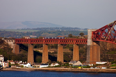 A class 170 Turbostar sets out over the mighty bridge in glorious October sunshine  with 2G55 1357 off Kirkcaldy to Edinburgh.