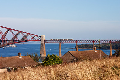 An unknown class 170 turbostar rumbles across the south viaduct of the Forth Bridge /with an unidentified working.  27/10/2005