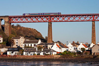 The unit passes high above the village of North Queensferry and slows for its station stop.