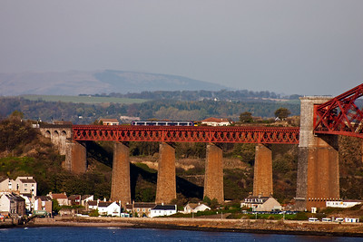 An unknown class 170 Turbostar passes high above North Queensferry as it accellerates away from the station stop. The service is 2K01 1245 from Edinburgh to Edinburgh via the anti clockwise Fife Circle.