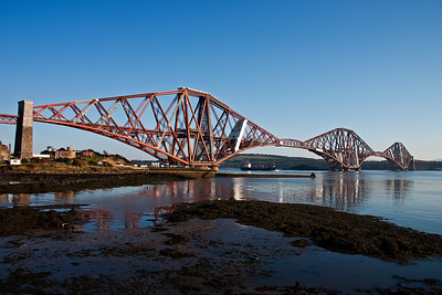 The Forth Bridge viewed from North Queensferry as the coaster Border Tartan passes below.