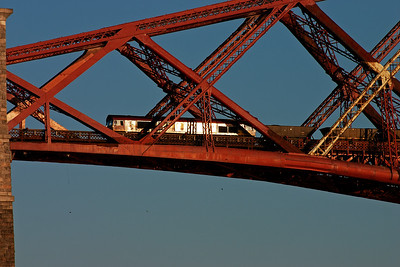 A few minutes later and the train is passing through the north cantilever and the sun glints off the side of 66183.