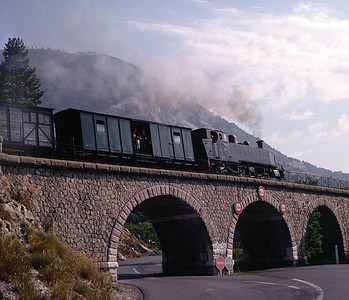 The line keeps close company with the road - here crossing a low viaduct at Morez 7/9/91