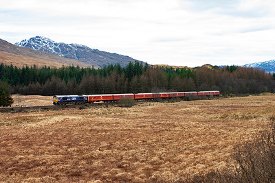 Running about 40 minutes late, the star of the show finally appears. GBRf 66728 makes history as it hauls a pair of class 325 Royal Mail EMU's over the West Highland line to Fort William.