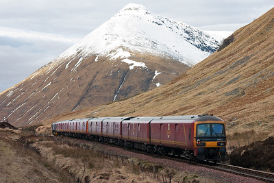 Beinn Dorian forms the dramatic backdrop to the County March as 66728 with 325008 and 325002 bends over the summit with the change of gradient from 1 in 63 up to 1 in 55 down with a very short level section between.